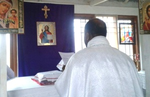 PRIEST AT ALTAR